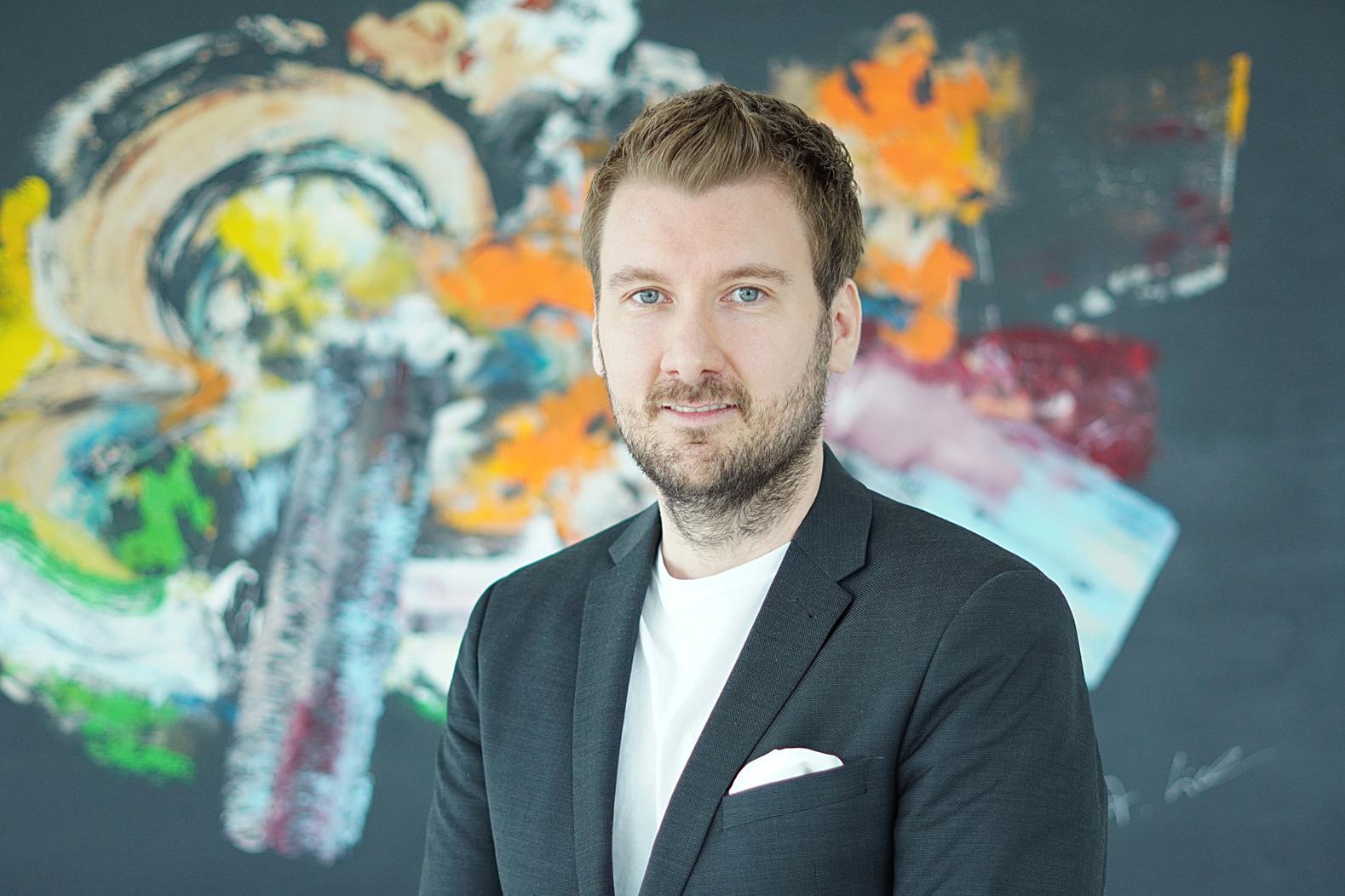 Porträt von Sebastian Merla, Gründer und Vorstandsmitglied der Deutschen Steuerberatergenossenschaft eG.